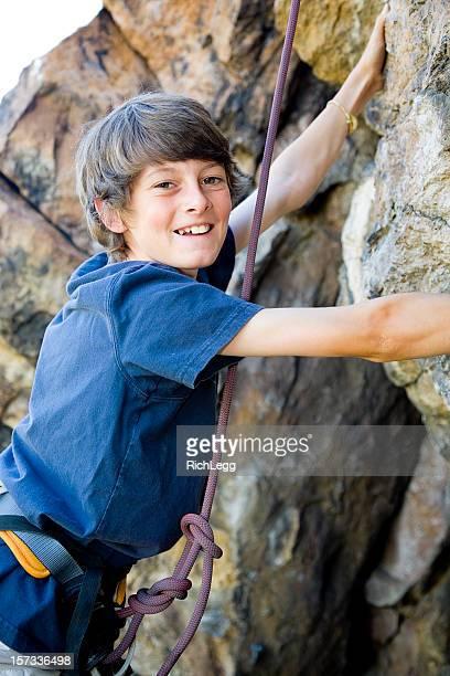 Young Man Rock Climbing