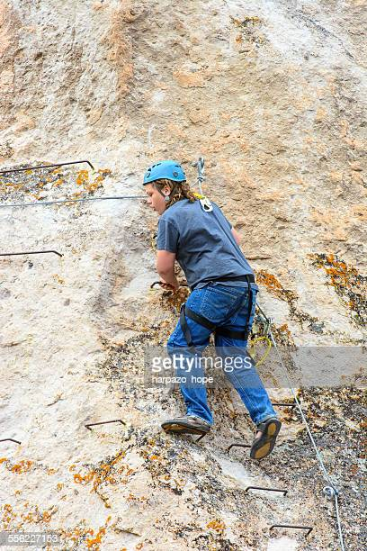 Young man rock climbing.