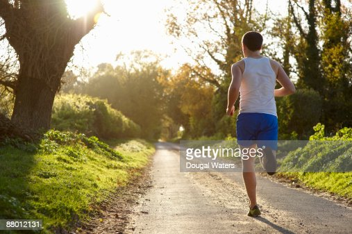 Young man running in countryside. : Stock Photo