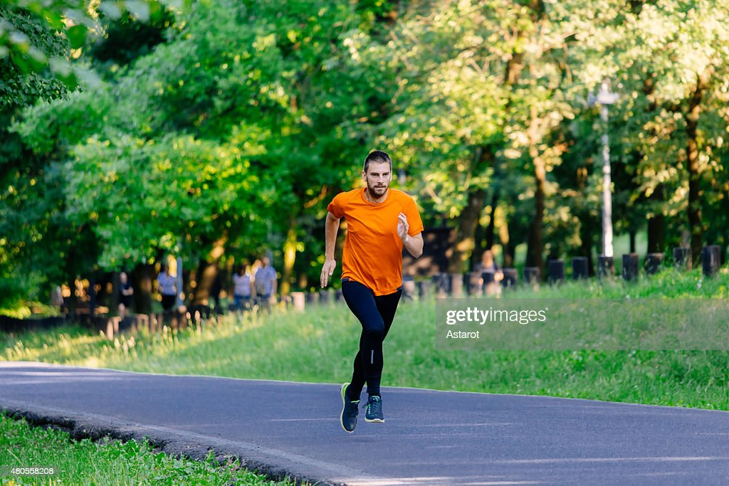 Young man running in the park : Stock Photo