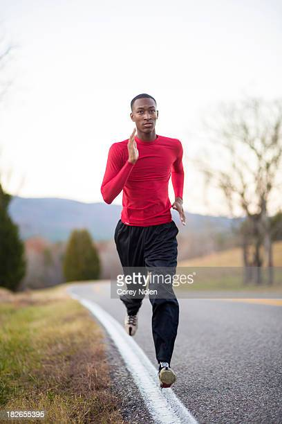 A young man runs down a country road near Cheaha State Park.