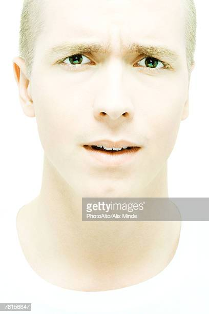 Young man scowling at camera