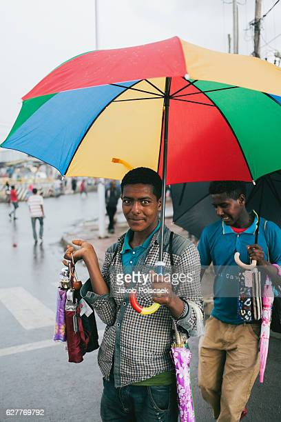 Young man selling umbrellas