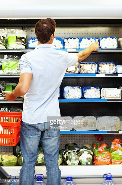 Young man shopping at super market