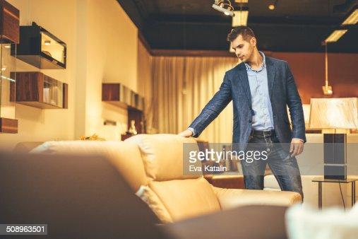 Young man shopping furniture