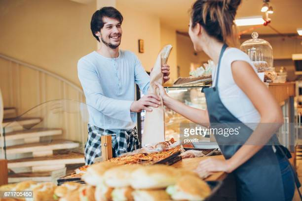 Young man shopping in the bakery