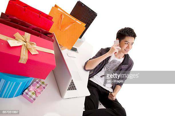 Young Man Shopping on the Phone