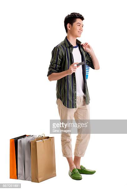 Young Man Shopping with Credit Card