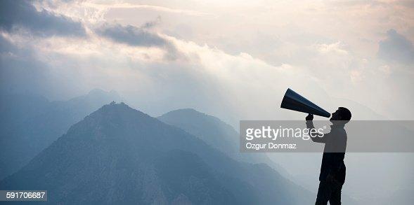 Young man shouting into megaphone