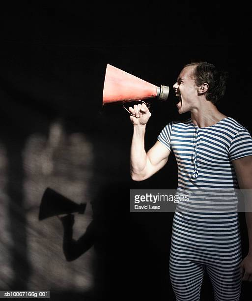 Young man shouting into megaphone