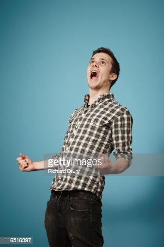 Young man shouting with joy : Stock Photo