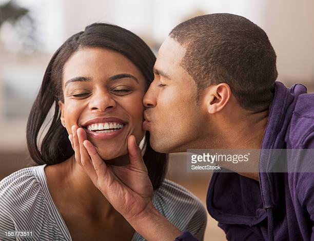 Young man showing affection with young woman