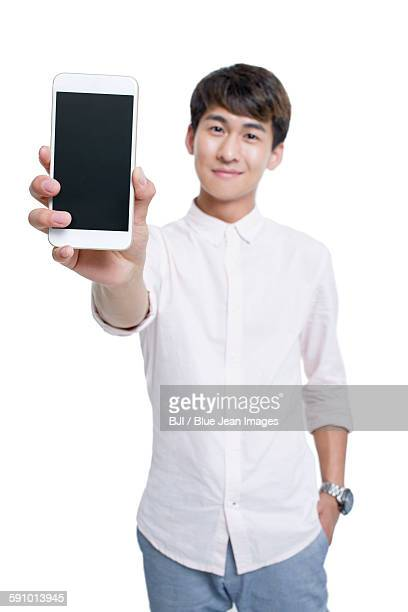 Young man showing smart phone