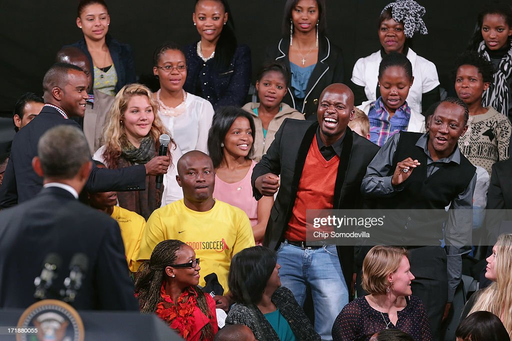 A young man shows his excitement as U.S. President <a gi-track='captionPersonalityLinkClicked' href=/galleries/search?phrase=Barack+Obama&family=editorial&specificpeople=203260 ng-click='$event.stopPropagation()'>Barack Obama</a> calls on him for a question during a 'town hall' meeting with the young African leaders at the University of Johannesburg in Soweto June 29, 2013 in Johannesburg, South Africa. South Africa is the second leg of Obama's three-country tour of the African continent, which includes Senegal and Tanzania.