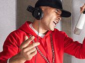 Young Man Singing in Studio