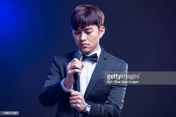 Young man singing with microphone