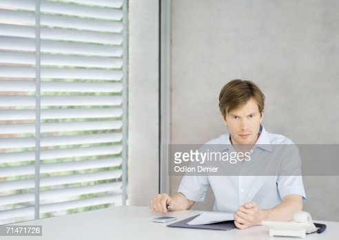 Young man sitting at desk