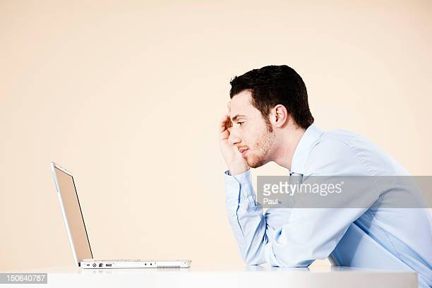 Young man sitting in front of laptop