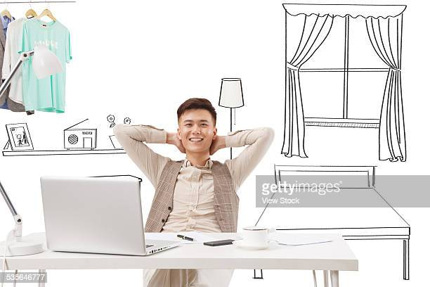 Young man sitting in front of table