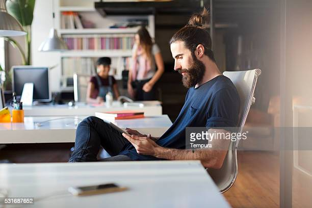 Young man sitting in his office and working.