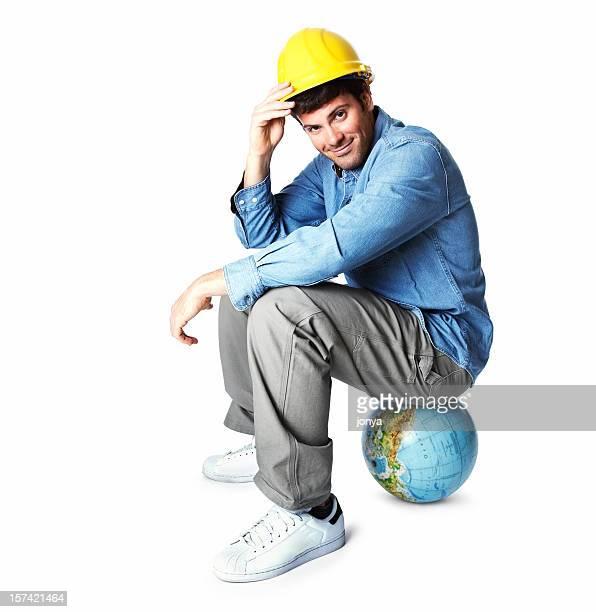 young man sitting on atlas wearing hardhat