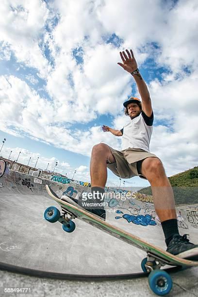 Young man skateboarding in a skatepark