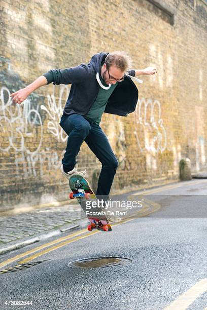 Young Man Skateboarding In Urban Environment