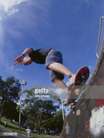 Young man skateboarding on ramp : Stock Photo