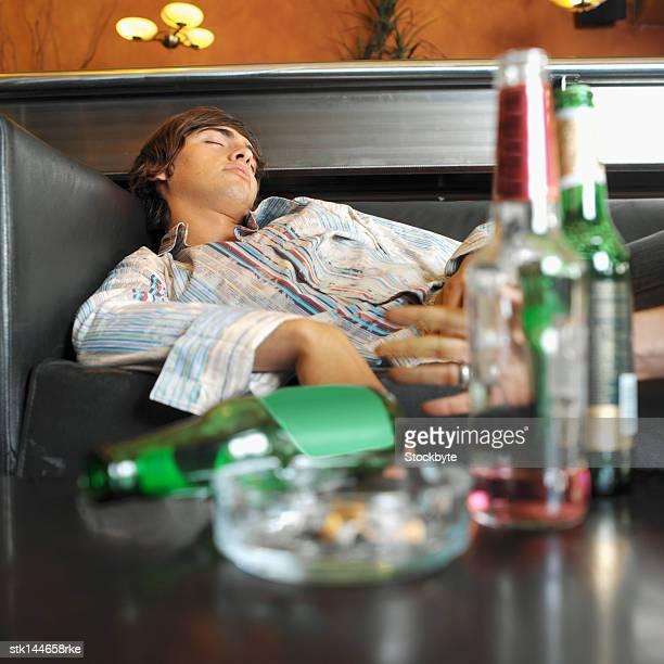 Young man sleeping in a bar
