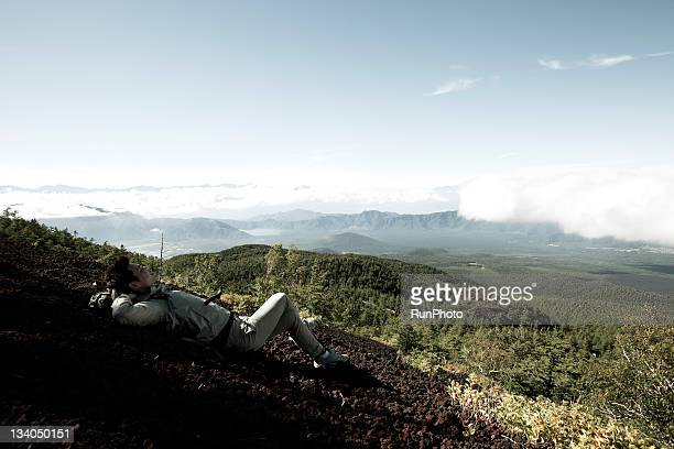 young man sleeping in the mountain