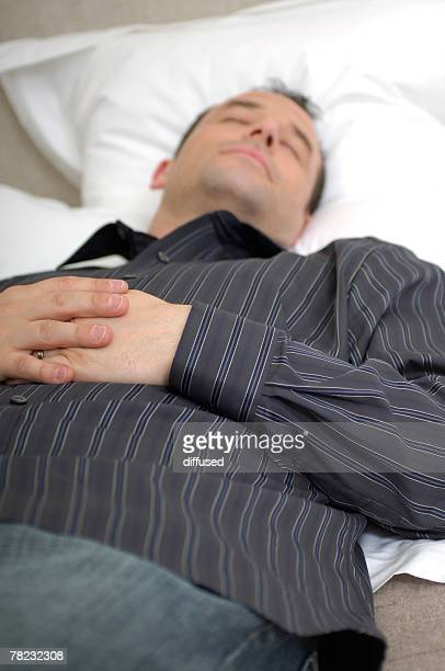 young man sleeping on his pillow