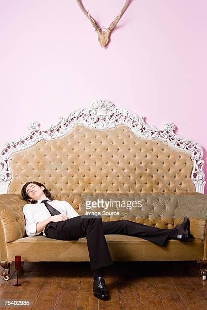 Young man sleeping on sofa