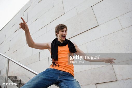 Young man sliding down railing : Foto de stock