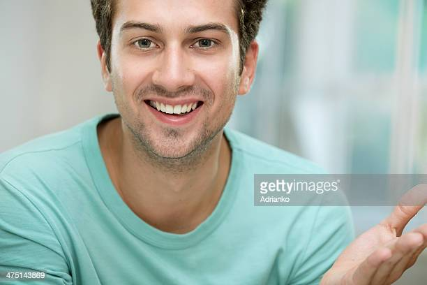 Young man smiling at camera