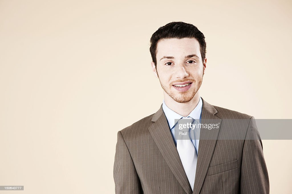 Young man smiling at camera, portrait