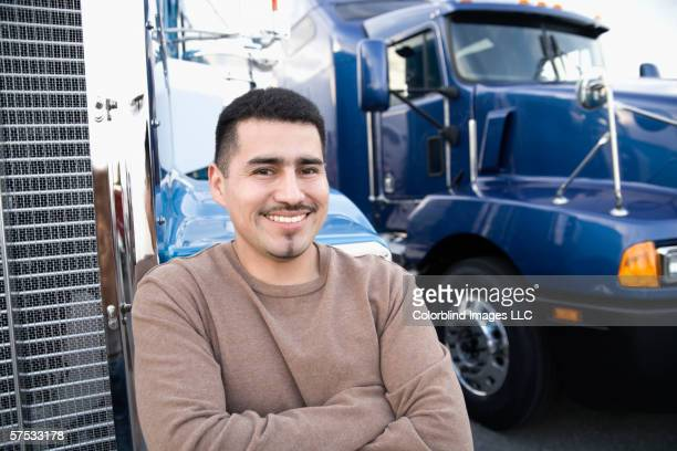 Young man smiling by his truck