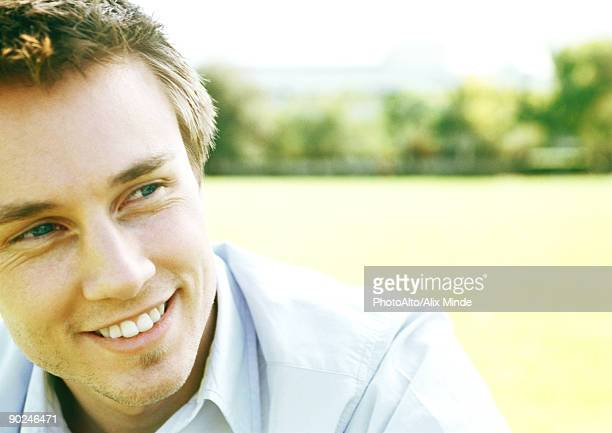 Young man smiling, close-up, portrait