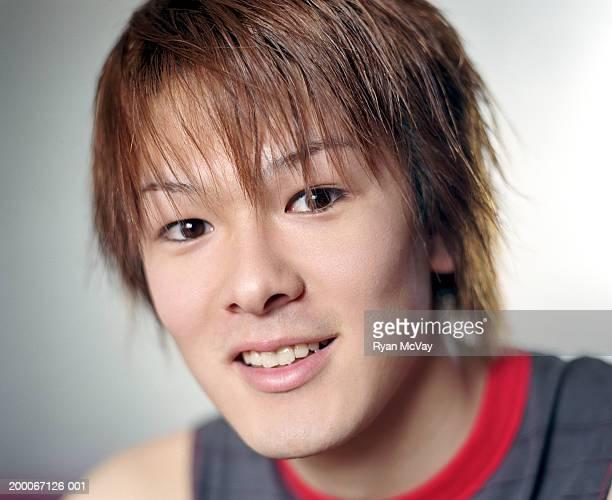 Young man smiling, portrait, close-up