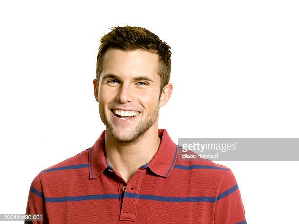Young man smiling, portrait