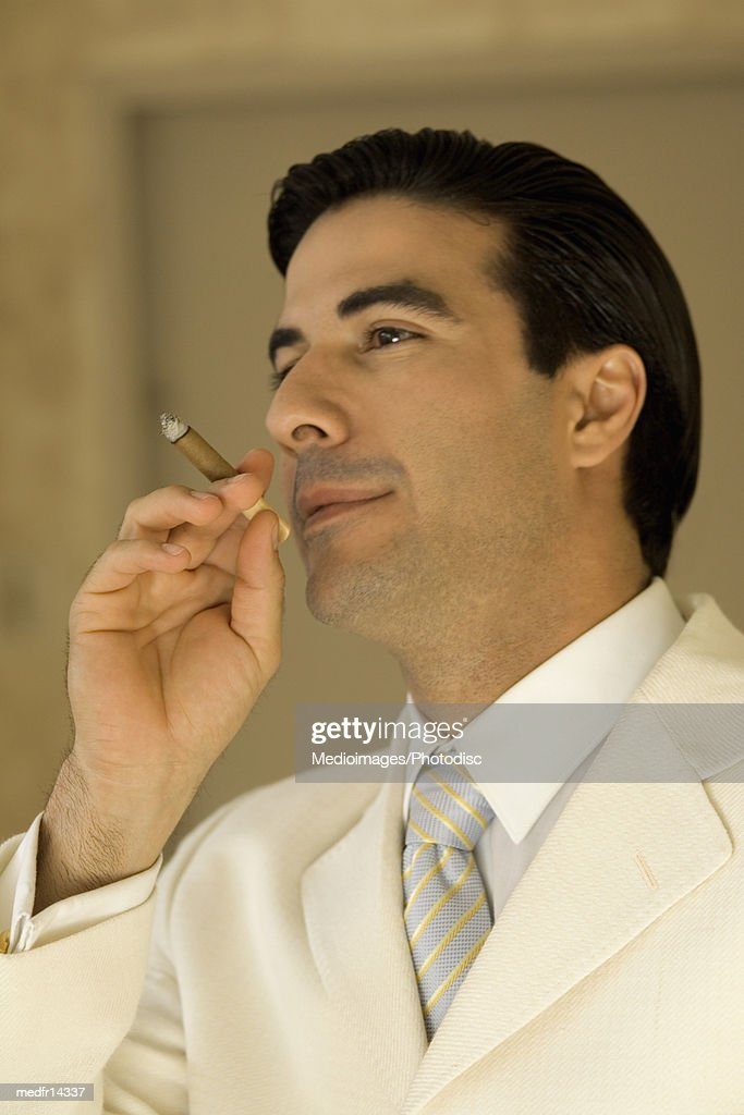 Young man smoking a cheroot : Stock Photo