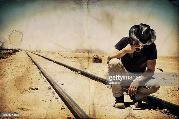 Young man smoking at railways