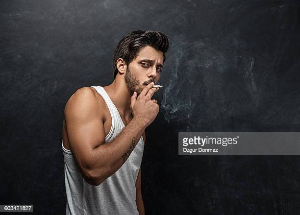 Young man smoking cigarette