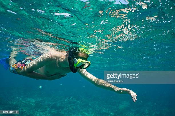 Young man snorkelling