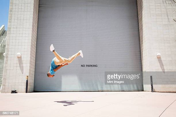 Young man somersaulting, a parcour runner,