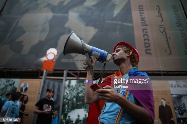 A young man speaks through a megafon as he leads the annual Gay Pride parade in Jerusalem Israel August 03 2017 22000 March in Jerusalem Pride Parade...