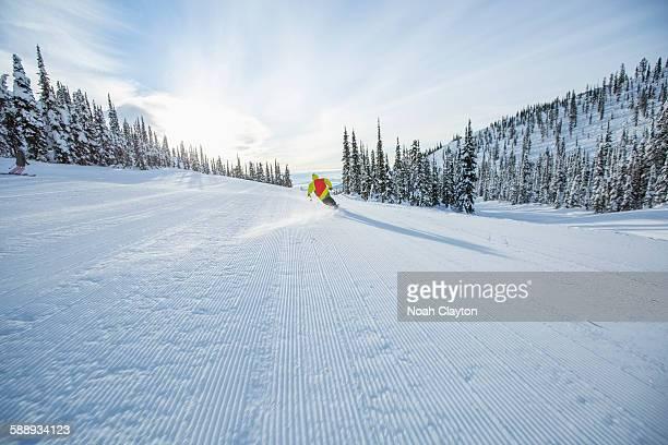 Young man speeding on ski slope