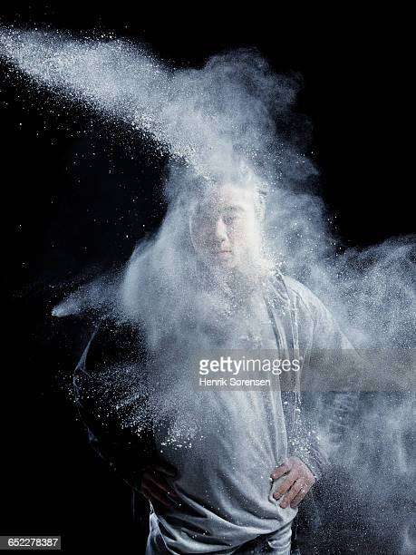 young man sprayed by powder