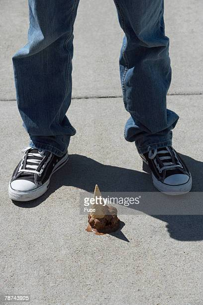 Young Man Standing by Dropped Ice Cream Cone
