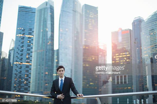 Young man standing in front of city skyline