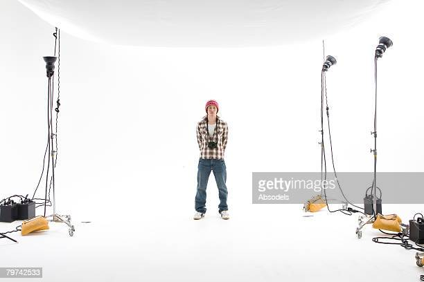 Young man standing in studio